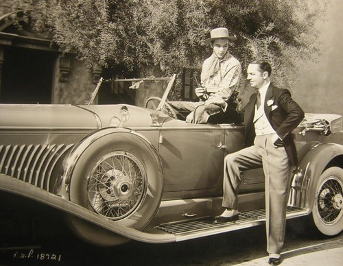 Gary Cooper and William Powell with Cooper's Duesenberg car - early 1930s