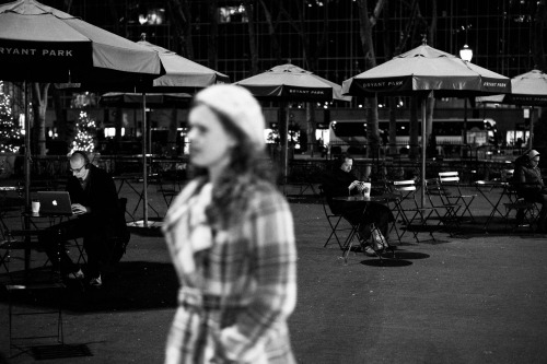 i took this last night in bryant park. it was cold, very cold. i don't know how the one guy could sit there and work on his computer.