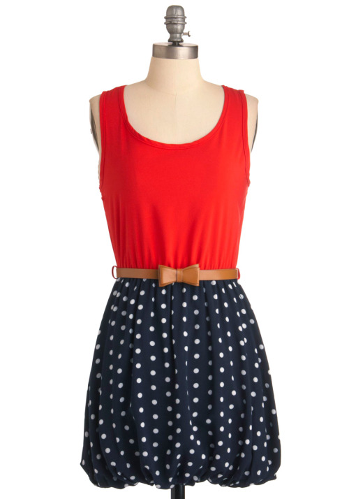 La-Di-Dots Dress, $47.99, Modcloth. Styling suggestion: Swap out the brown belt for a gold belt. Accessorize with gold cuff bracelets and a pair of red shoes. Treat yourself to an invisible jet.