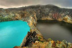 "pigcharmer:  The Lakes of Mount Kelimutu, Indonesia are considered to be the resting place for departed souls, the lakes are locally referred to as ""the lake of evil spirits"".  All 3 lakes change color from blue to green to black or red unpredictably"