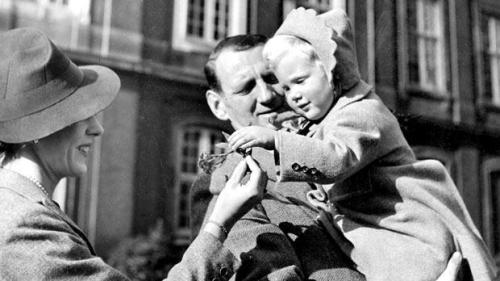 Denmark's late King Frederik IX and Queen Ingrid holding their two-year-old and eldest daughter Pincess Margrethe in 1942.