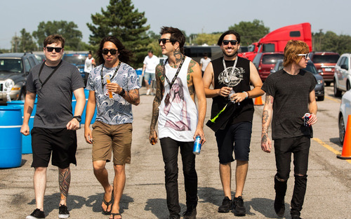im-not-a-zombie:  Of Mice & Men photo by Adam Elmakias