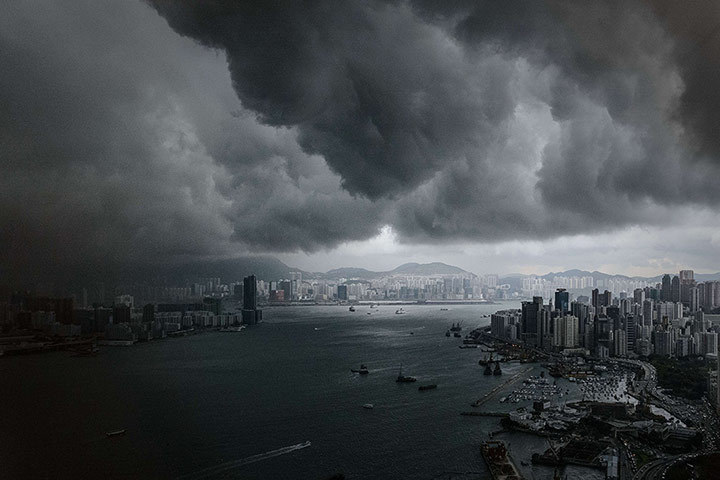 davidcliffordphoto:  Clouds build up over the Victoria harbour before a storm in Hong Kong Photograph: Philippe Lopez/AFP  /via From the Observer | guardian.co.uk