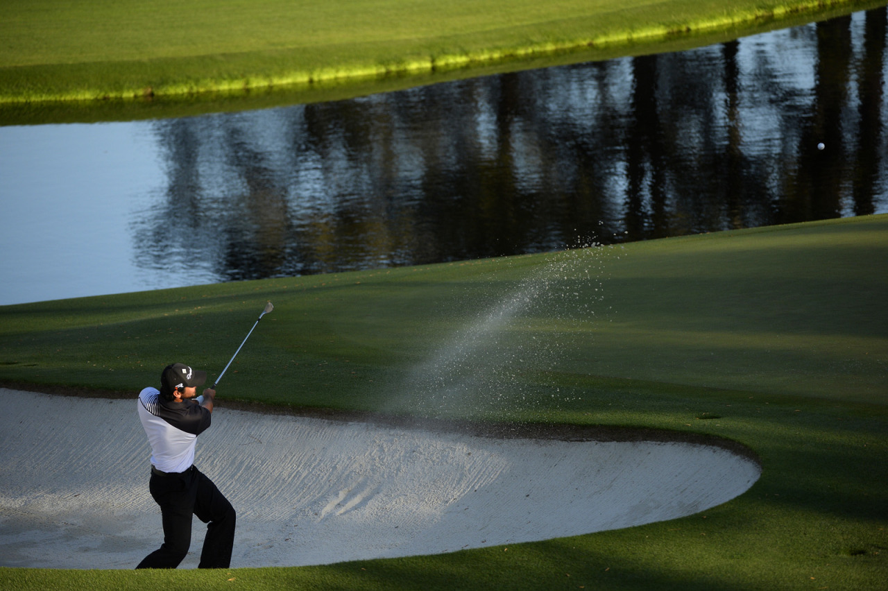 Jason Day plays a shot out of a bunker on the par-5 15th hole during the second round of the 2013 Masters.   Photograph by Dom Furore for Golf Digest