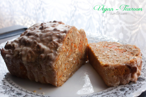 vegan-tearoom:  Banana Carrot and Oat Cake (With Lemon Icing) Cake ingredients: 1 1/2 cups wholemeal self raising flour 1/2 cup rolled oats pinch of salt  1 tsp cinnamon 1/2 cup non-dairy milk (I used soy) 1/2 cup raw sugar 1 tsp vanilla extract 3 large over ripe bananas, mashed 1/2 cup fresh carrot, grated Icing plain icing sugar margarine lemon juice Method: Mash up your bananas in a large bowl, mix in non-dairy milk and vanilla extract until well combined.  Add all the dry ingredients and form a dough fold the grated carrot in gently Pour cake mixture into a well greased cake pan and bake at 180 degrees celsius (or 350 farenheit) for about 40 mins Icing: In a smaller bowl add about a 1/3 cup of icing sugar with a tablespoon of margarine. Fold together well.  Add tablespoon or so of lemon juice and mix, if the mixture is too runny add more icing sugar. I never use exact measurements for my icing so its really just until you find a good liquid to sugar ratio, so that its not runnier or thicker than you'd like it to be. I made the very silly mistake of being too impatient to wait for the cake to cool before trying to ice it. Don't make the same mistake I did!