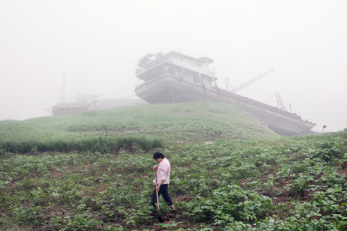 Abandoned ships grounded by flooding along the Yangtze River, Chongqing, 2012 John Francis Petersvia TIME