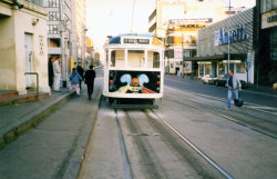 tram, Melbourne [artist Michael Leunig] Just went to the tram exhibition at the Old Treasury Building. Reminded me of this, one of a whole fleet of artist-painted trams in the late 80s/early 90s. Now there's just advertising all over trams.