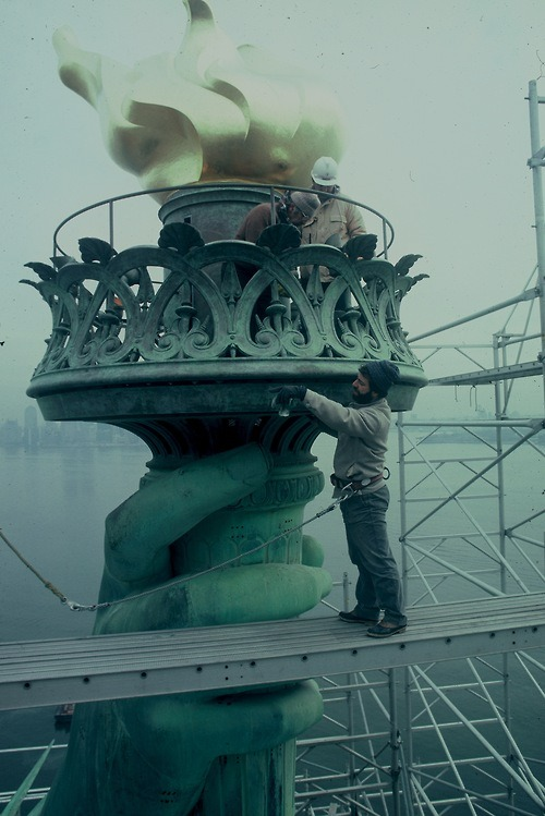 "razorshapes:  Renovation of the torch of the Statue of Liberty ""The ""new"" torch of the Statue of Liberty in New York City, which was replaced in 1916. In 1984, the renovation restored the original design. The torch, found to have been leaking water since the 1916 alterations, and was replaced with an exact replica of Fréderic Bartholdi's unaltered torch."""