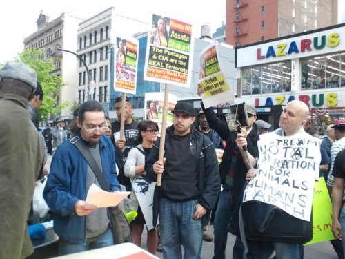 "fuckyeahmarxismleninism:  Harlem, New York: ""Hands Off Assata Shakur"" protest called by the Black Is Back Coalition, May 9, 2013. Photos by Ken Bleezewalker"
