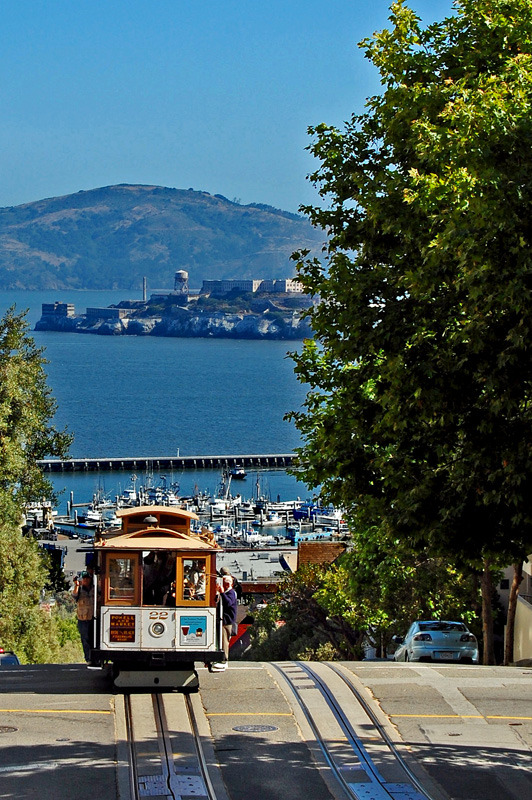visitheworld:  The famous cable car and Alcatraz Island in San Francisco, USA (by alexisborel).