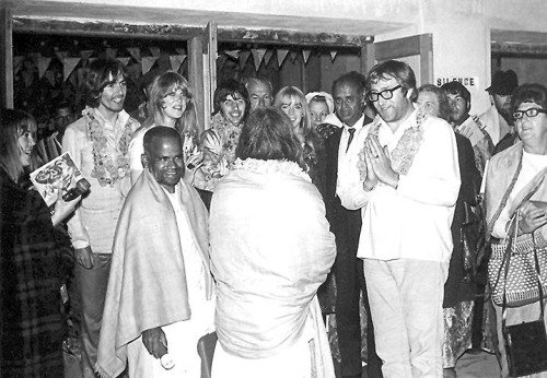 "thoseliverpoollads:  In India being greeted by The Maharishi Yogi  Also pictured is the Gentle Giant Mal Evans who is greeting the Maharishi directly.  February 25, 1968 - The Beatles party wishing Maharishi Mahesh Yogi ""Namaste"" as they leave the lecture hall after George's 25th birthday celebration at the Rishikesh ashram. George, Pattie, Ringo, Maureen, Mal Evans, Paul and Mike Love shown in the crowd."