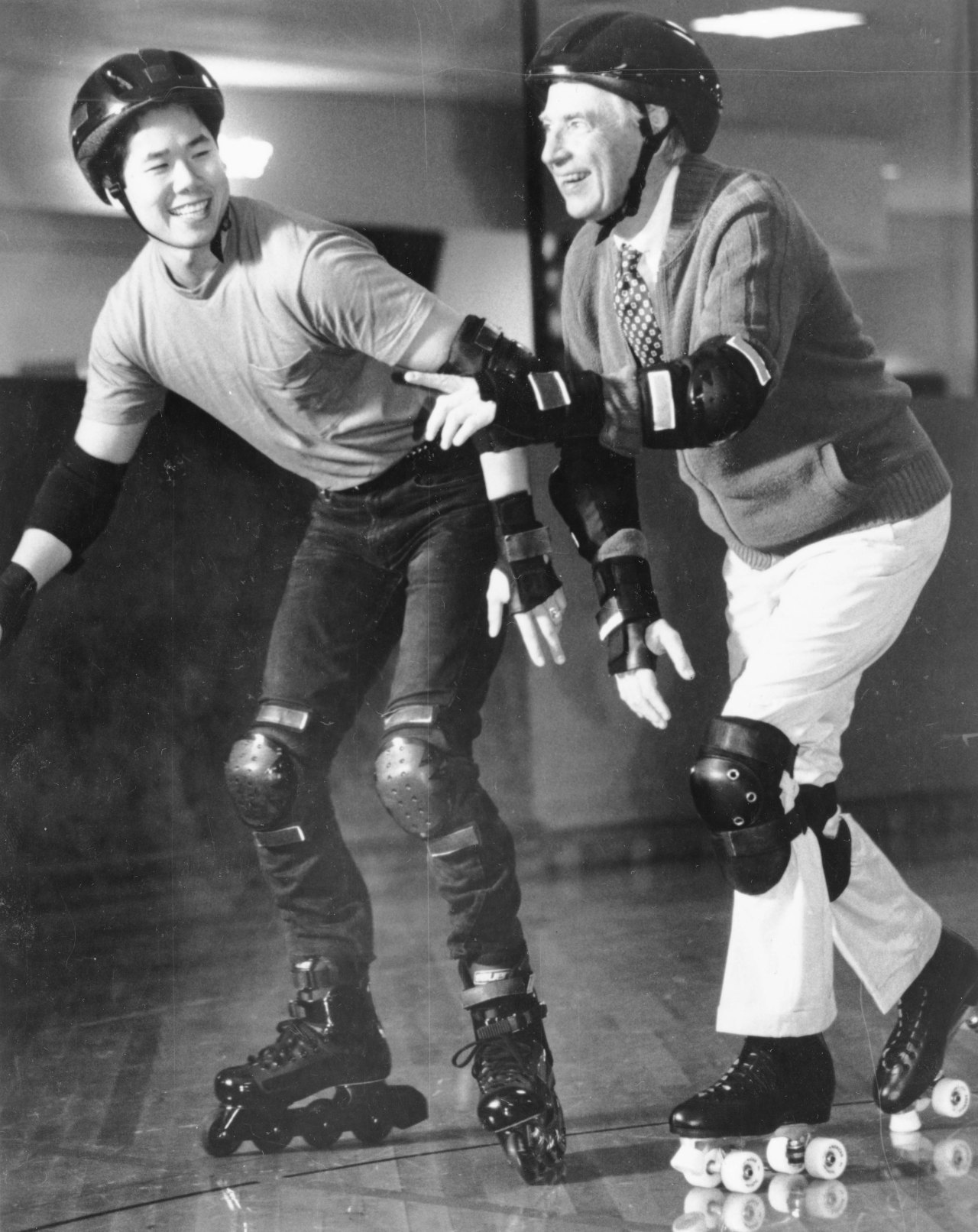 Mister Rogers learns safety tips on roller skates, 1995