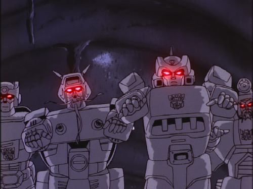 "Kup, Wreck-Gar, Springer, and Scourge as energy vampires. Screen capture from the Generation 1 cartoon, The Transformers, ""The Dweller in the Depths""."