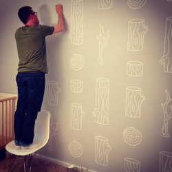 I had blogged about the patterned wall I was going to create for our nursery last week, and here is the progress. I'm about 60% done and it is looking awesome! (I'm in the photo for size reference)