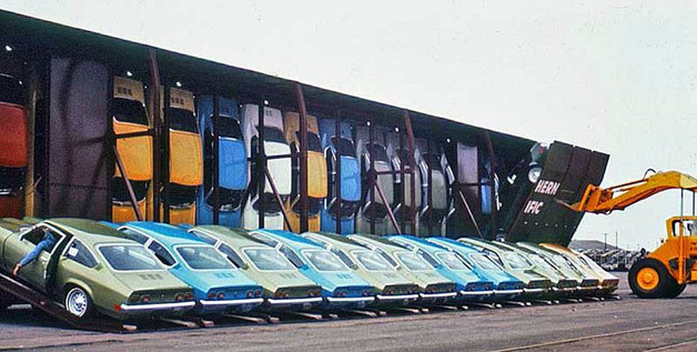 """Vert-A-Pac train cars kept your Chevy Vega's price in check"" At the time, rail cars could fit 15 vehicles each, but Chevrolet was able to lower shipping costs by making it possible to ship 30 Vegas per rail car, in turn allowing the price of the Vega to remain as low as possible. Each rail car had 30 doors that would fold down so that a Vega could be strapped on, and then a forklift would come along and lift the door into place. All the cars were positioned nose down, and since they were shipped with all of their required fluids, certain aspects had to be designed specifically for this type of shipping, including an oil baffle in the engine, a special battery and even a repositioned windshield washer reservoir. __________________ Now, the Vega wasn't one of the best cars on the road but this kind of design thinking is noteworthy.  I imagine one major necessity to maximizing space at the time was the oil embargo. Shipping costs are positively correlated with fuel costs so it's a wonder that more car manufacturers, even today, fail to consider this option of transporting their finished goods. Also, the challenge of managing the fluids in electric vehicles would be dramatically reduced."