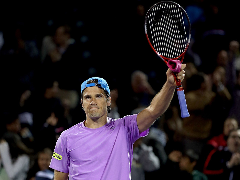"Not that you need another reason to like Tommy Haas, but we will give you one anyway. The 34-year-old became the oldest tennis player to upset a No. 1 after he beat Novak Djokovic at the Sony Open on Tuesday night. Even better: This outfit he wore for the last few games. The Associated Press say that he ""won ugly."" Lavender shirt, red sweatband, black shoes with lime trim, and a blue hat. Haas doesn't really care. Because he won. ""Yeah, I'm pretty pathetic I think when it comes to colour matching,"" he said after the match. ""Sometimes I look at myself in the mirror before I go out and I'm like, 'Jeez, what was I thinking?' I guess if I maybe had a clothing contract it would be different."" (Photo: Matthew Stockman/Getty Images)"