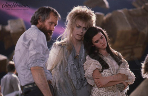briannacherrygarcia:  muppetmayhem:    Jim, David Bowie, and Jennifer Connelly on the set of Labyrinth.     I just noticed Sarah is holding Jareth's hand around her waist. I ship them so hard it hurts. Jim, you're awesome too.
