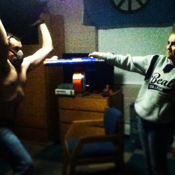Me as #Bane with Sarah's little sister crushing her with a chair while she shoots me with Nerf