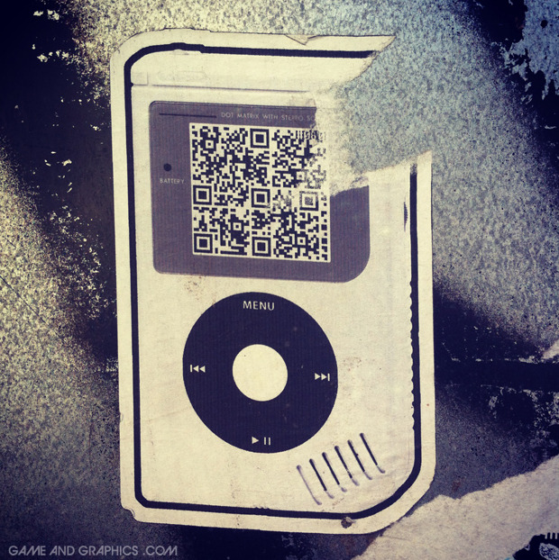 gameandgraphics:  Game Boy + iPod street art found in Barcelona. The QR code leads you to the Rémi Gaillard PacMan video. Pic from my instagram account, my id is @daruma