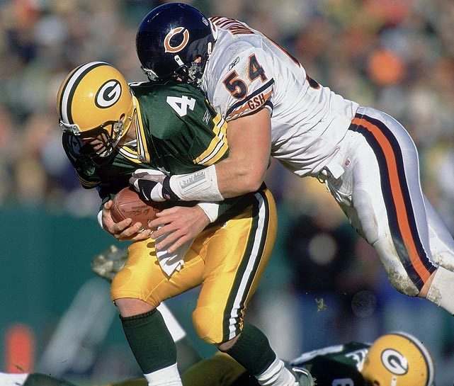 siphotos:  Brian Urlacher sacks Brett Favre during a 2001 Bears-Packers game. Urlacher, the 2000 Defensive Rookie of the Year, 2005 Defensive Player of the Year and eight-time Pro Bowler, retired on Wednesday. (John Biever/SI) GALLERY: Classic Photos of Brian Urlacher