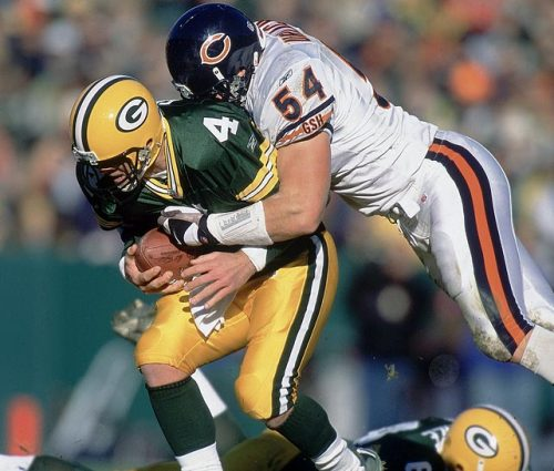 siphotos:  Brian Urlacher sacks Brett Favre during a 2001 Bears-Packers game. Urlacher, the 2000 Defensive Rookie of the Year, 2005 Defensive Player of the Year and eight-time Pro Bowler, retired on Wednesday. (John Biever/SI) GALLERY: Classic Photos of Brian Urlacher  A Midway Monster says farewell.