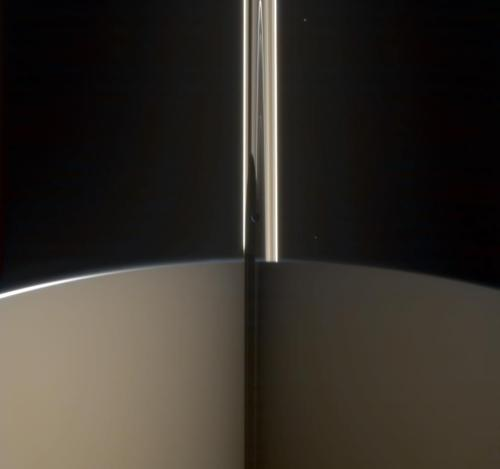 Cassini spies Mimas hiding in Saturn's rings      Credit: NASA / JPL / SSI / Gordan Ugarkovic