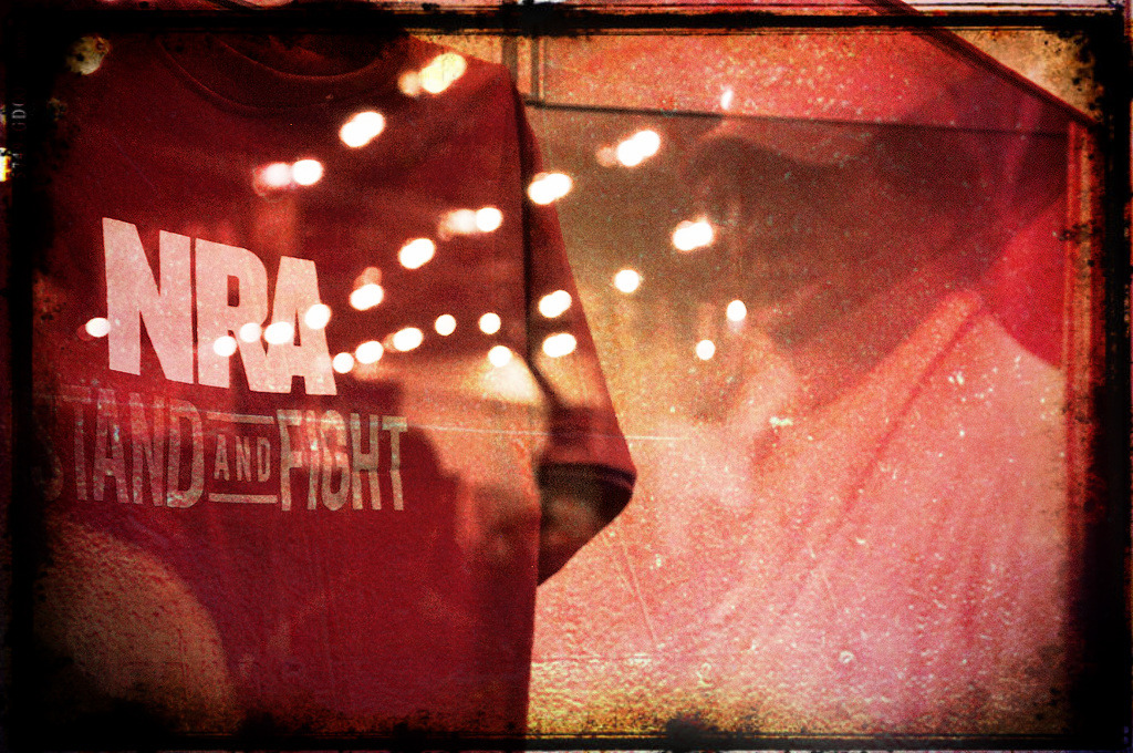 "NRA Turns to the Tried and Failed Politics of the Tea Party.  In some ways, new NRA president Jim Porter is the best thing to happen to the  common sense regulators' side of the argument. He approaches the issue  with the same subtlety and finesse of a brain surgeon with a sledge hammer. He  seems to be an all or nothing, slash and burn type, who practices rightwing  politics of exclusion. Josh Horwitz, executive director of the Coalition to Stop  Gun Violence says that Porter drags the National Rifle Association even farther  ""into the extremist camp."" ""With Jim Porter, they've gone full crazy,"" he  says.    He also represents just about every failed approach to national politics  imaginable. At the NRA convention this weekend, he called for a ""culture war"" —  I guess because rightwing culture wars have gone so swimmingly lately. And yes,  he is far outside the mainstream.  Talking Points Memo: Porter has  called President Barack Obama a ""fake president,"" Attorney General Eric Holder  ""rabidly un-American"" and the U.S. Civil War the ""War of Northern Aggression.""  On Friday, he repeated his call for training every U.S. citizen in the use of  standard military firearms, to allow them to defend themselves against  tyranny. As I've pointed out before, calling for the taking up of arms to ""fight tyranny""  is just a more pleasant-sounding way of endorsing the assassination and murder of your  fellow Americans. And ""War of northern aggression"" means exactly what it seems to  mean; a revisionist take that puts the north at fault in the Civil War,  completely ignoring and — even denying — the role of racism and slavery in launching  that war. The exclusionist aim straight at white voters is unmistakable here and  it's the same tactic that's cost Republicans black voters nearly universally. ""Fake president"" is an obvious birther reference. At a time when the  Republican Party is trying to shed these tendencies, Porter drags them back in.  I doubt he's making many friends over at GOP HQ. You might  remember Sharron Angle, a Tea Party candidate who ran in 2010. She was  another Todd Akin type and what cost her election — at least in part — was her  endorsement of ""Second Amendment remedies"" to deal with what she saw as an  unresponsive congress and even to remove her election opponent, Harry Reid, from  office. In other words, she pretty much endorsed assassinating Harry Reid and  any other congress member who's politics you don't like. People found this kind of talk a tad bit terrorist-sounding. And it's nearly indistinguishable from Porter's rhetoric. I doubt the average person will  like it any better coming from him. So we have an NRA president practicing  failed rightwing politics and repeating far-right talking points that everyone  else finds insane. But keep in mind that the NRA's purpose here is different  from the GOP's. The Republican Party's purpose is to get Republicans elected.  The NRA's purpose is to make money for small arms merchants. The NRA made an  alliance with the GOP long ago, but that doesn't mean they work hand in hand.  What Porter's trying to do here is pretty simple — collect all the white male  voters turned off by the GOP's rebranding effort under the NRA banner. You get  all the racists and the homophobes and the Christian supremacists and various and sundry other extremists, then you try to  sell them back to the party. A big problem with the GOP rebranding effort has  been in trying to win over new voters, while keeping these frootloops in the  flock. Porter seems to believe he can turn these people into single-issue voters  and use them as leverage to keep the GOP from caving in when the pressure  builds. And so NRA gatherings start to look like Tea Party rallies — thinly veiled racism and all. It's a bad strategy, because  eventually the Republican Party will realize that pandering to these voters just  plain isn't worth it. After all, the rebranding effort is the first glimmer of a  dawning realization that these people are costing more votes than they bring. But  in the meantime, the NRA will do what the Tea Party did — enable completely  insane candidates to win primaries, then lose general elections with their  frothing nutbaggery. On the other hand, what else can Porter do? His  ""culture war"" is already being fought and he's losing it badly. Gun ownership is down, support for gun regulation is high —  all you can really do is buy time while you try to figure out how to turn this  around. The tone of the NRA convention was triumphalist, but the reality — as  made clear by the NRA's strategy going forward — is that their ""movement"" is  treading water. -Wisco [photo by Gerald Rich]"