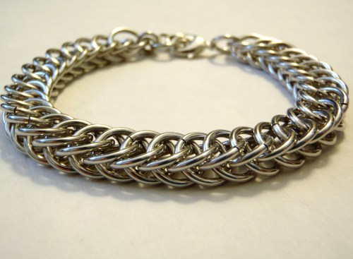 This elegant chainmail bracelet is now up on Etsy! ^_^ I really love this weave. It is simple and not rope-y. It flows quite nicely. Also, it looks good on anyone! :D https://www.etsy.com/listing/127548872/half-persian-chainmaille-bracelet