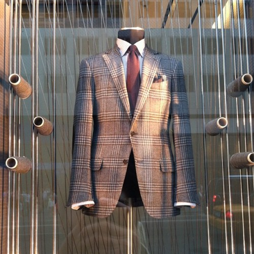 downeastandout:  A jacket in a window