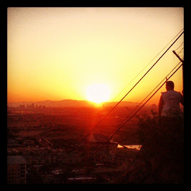 "Staring into the #sunset over #WhiteTankMountains and #DowntownPhoenix #skyline from #HaydenButte #Tempe #Arizona #whpsilhouettes #az365 #instagramaz #instaaz #igersphx #phx #igersusa #silhouette #azsunset  (at Summit ""A"" Mountain)"