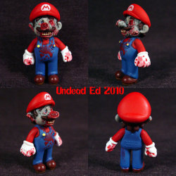 What would Mario look like as a zombie: Here is a toy model of Mario after turning into a mad looking zombie it does look pretty cool to me resident evil style. very well made i wouldn't mind one of these models to be honest.