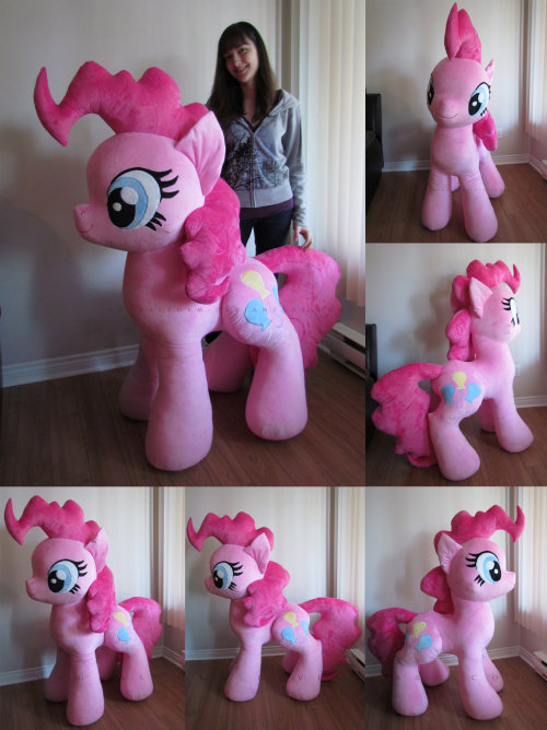 "Holy pink ponies, Batman! DeviantARTist MagnaStorm (aka Elise) was commissioned to create this incredibly awesome Giant Plush Pinkie Pie, and boy did she do a fantastic job.  ""4 days of 8-10 hours of work, 5.5m of minky and a couple wounds later Pinkie is now complete. She stands at about 55"" (4.5ft) from her hooves to the hightest part of her mane and weighs a whooping 15lbs. As pictured, she can stand unaided thanks to some cushioning foam inside of her (to learn how I did it check this journal: [link]). Her eyes and cutie mark are satin stitched instead of machine embroidered because they were too big for my embroidery machine. The lines and details in her mane were also satin stitched.""  And just in case you're wondering (because we'll admit we were) this prodigious Pinkie Pie cannot support a person's weight (that would required a solid internal frame). She's meant for cuddling, not riding. Visit the MagnaStorm DeviantART gallery to view more of Elise's amazing plush creations. [via Neatorama]"