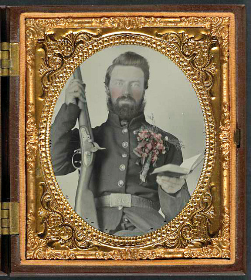 Private David Lowry, of Company E, 25th Virginia Cavalry Regiment, Company A, 41st Virginia Infantry Regiment, and Company D, 47th Virginia Infantry Regiment, in uniform and corsage of flowers with musket and book. Confederate States of America.—Army.—Virginia Cavalry Regiment Like the Union Army, most Confederate soldiers were under 30. More than half the Confederate soldiers were farmers, although only a very small percentage of them owned slaves. The others came from many different types of jobs: carpenters, clerks, blacksmiths, students, etc. As in the Northern army, the Southern soldiers had educational backgrounds that ranged from university degrees to illiteracy. Cavalry and artillery regiments attracted wealthier and more highly educated men than infantry units in the South, and a Confederate foot soldier was more likely to be illiterate than his Union counterpart. It is not certain how many foreigners fought for the Confederacy, but the number seems to be in the tens of thousands. Digital ID:  (digital file from original item) ppmsca 32062 http://hdl.loc.gov/loc.pnp/ppmsca.32062  Reproduction Number: LC-DIG-ppmsca-32682 (digital file from original, tonality adjusted) LC-DIG-ppmsca-32062 (digital file from original item) Repository: Library of Congress Prints and Photographs Division Washington, D.C. 20540 USA http://hdl.loc.gov/loc.pnp/pp.print Source: The Civil War Trust  http://www.civilwar.org/education/history/warfare-and-logistics/warfare/who-fought.html