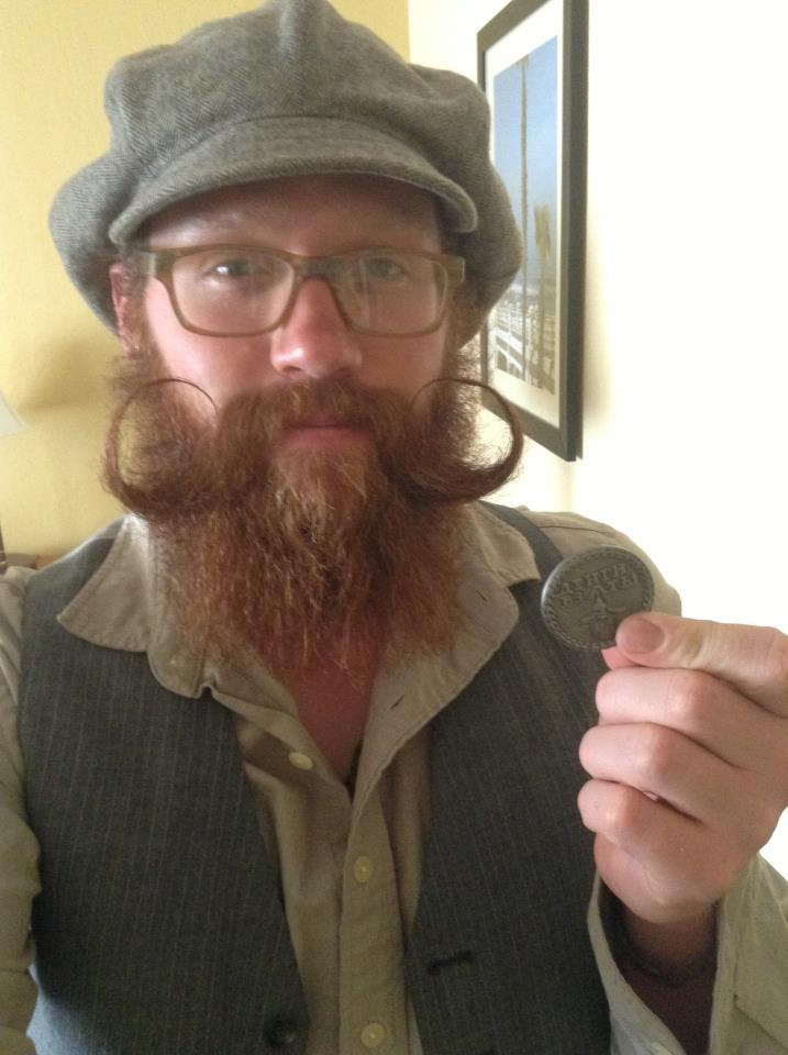 "This is a great look. Joe Durban with his Beard Token. He wrote, ""I carry it everywhere I go. I can't wait until I meet a fellow bearded man carrying his as well."" I look forward to my first encounter with one in the wild as well."