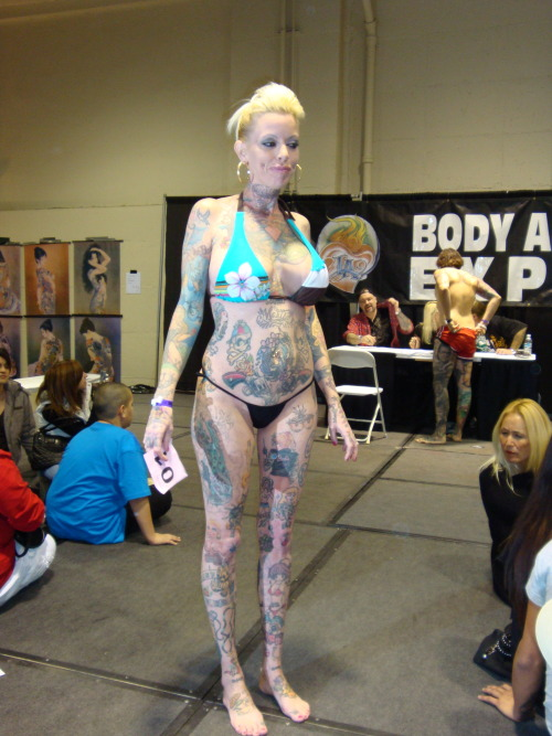 Woman covered with traditional-style tattoos; Body Art Expo, Pomona, CA, January 2009.