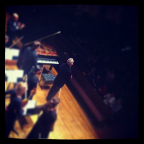 willroanephoto:  Jeremy Denk '90 prepares to take a bow at the conclusion of Mozart's Piano Concerto in C Major, K. 467 during the preview concert in Oberlin before the tour.