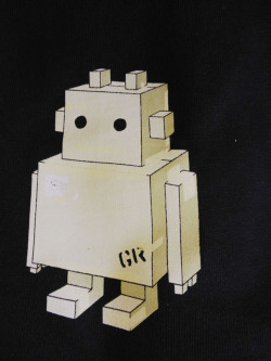Cardboard Robot! I used to make robots like this out of cardboard way back in the day. Masking tape ruled.