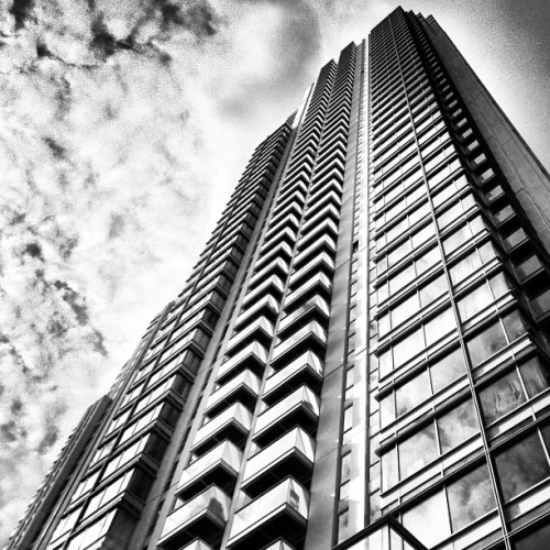 Column mono • #panpeninsula #1millharbour #skyscraper #southquay #londondocklands #eastlondon #london #england #greatbritain #unitedkingdom #architecture #steel #glass #balconies #sky #cloud #reflection #diagonal #up #spring #morning #20thMay #2013 #bw #mono #blackandwhite #inkwell #lux #st #thest  (at Pan Peninsula)