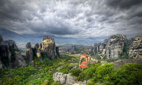 "Meteora means…""suspended in the air""    Above the town of Kalambaka, on the north western edge of Greece, giant rock formations, like enormous fingers pointing to the heavens, are a protected Unesco World Heritage Site and go by the name Meteora – which literally means ""suspended in the air""."