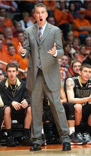 Purdue head coach Matt Painter reacts to an official's call during the first half of their NCAA college basketball game against Purdue, Wednesday, Feb. 13, 2013, in Champaign, Ill. (AP Photo/Darrell Hoemann) —— That wasn't the only call he was upset about; in fact, with 8:08 left in the game, Coach Painter got double technical fouls AND ejected from the game after some serious arguing with the refs.  Purdue lost at Illinois 79-59
