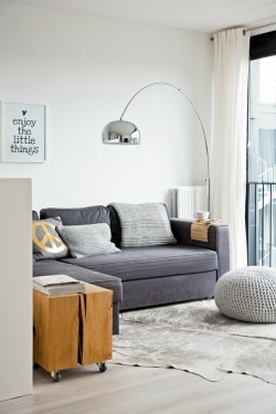 Karlijn de Jong's living room - good small space idea like calm simple palette, white walls, art & coffee / side table on wheels