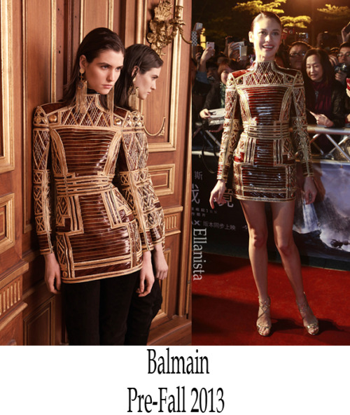 Red Carpet Fashion Olga Kurylenko wore a warrior inspired Balmain mini dress paired with Jimmy Choo 'Lance' sandals to the 'Oblivion' premiere in Taipei, Taiwan. She looks better than the model.