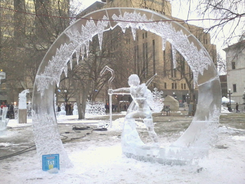 his-azure-eyes:  The Jack Frost ice sculpture took First Place at the St. Paul Winter Carnival in Minnesota. I wanna go hug it.Believe in the Guardians!
