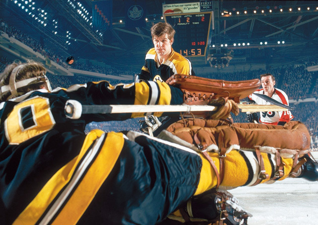 Bobby Orr helps clear a puck during a 1970 Bruins-Flyers game. (John G. Zimmerman/SI) GALLERY: Classic Photos of Bobby Orr