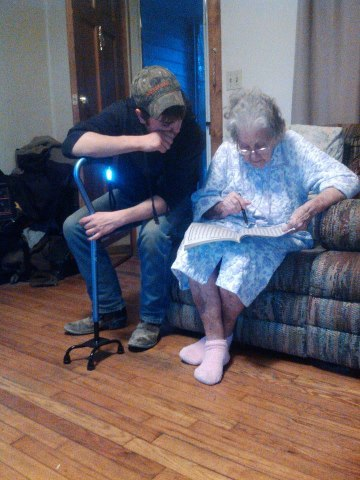 Awhh my baby helpin his granny find her word inna crossword puzzle(:
