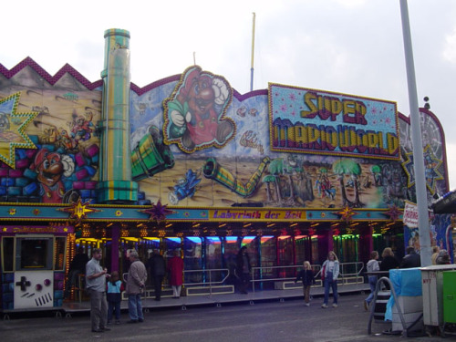 magnetbeam:  poisonmushroom-org:  suppermariobroth:  A German fair attraction themed around Mario.  Seems legit. Where do I sign up?  Buy your tickets in that Game Boy.
