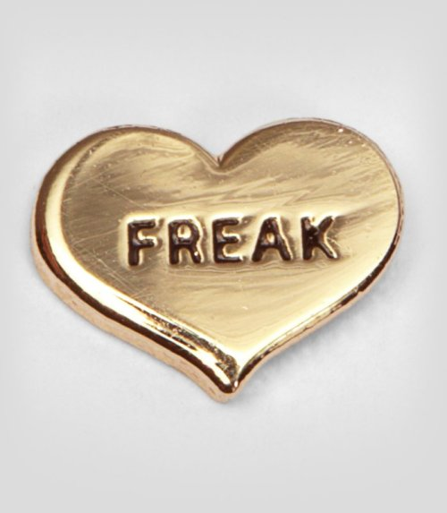 """Show the world you love yourself exactly as you are with this singlette earring. With the word """"freak"""" embossed in bold capital letters, you'll be letting your freak flag fly in a small, subversive way every day."""