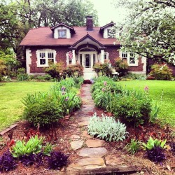 This place may win most #adorable #house ever. #cottage #landscaping #flowers #lilies #irises #spring #homes #gardens #nashville #tennessee #instagood #iphoneography #want