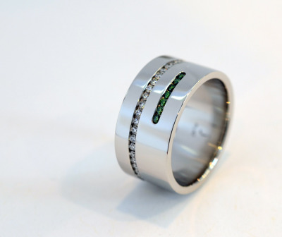 custom platinum ring with white and green diamonds by J ALBRECHT DESIGNS