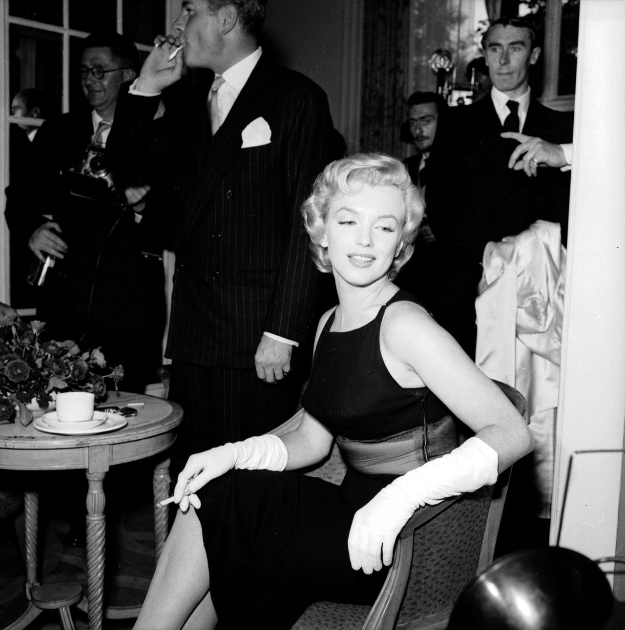 Marilyn Monroe at a press conference in England, 1956.